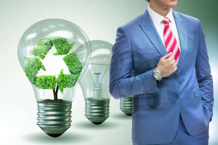 Green energy ecology concept with businessman