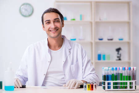 Young male chemist working in the lab Stok Fotoğraf