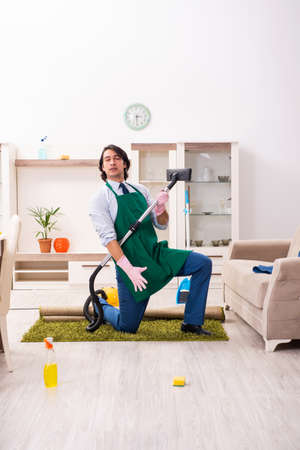Young businessman cleaning the house Stock Photo