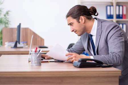 Unhappy male businessman in the office