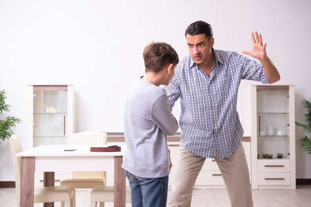 Father beating and punishing his sone Stockfoto