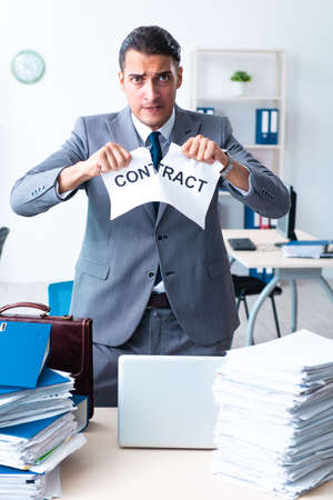 Businessman with heavy paperwork workload