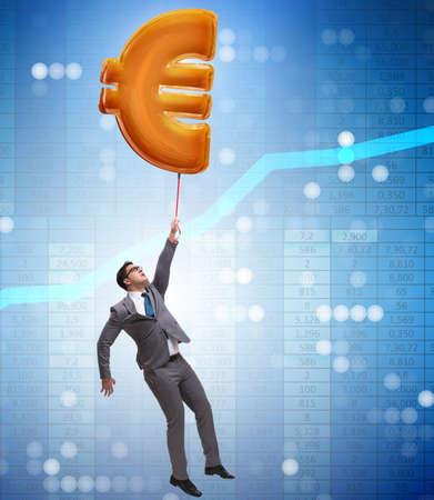 Businessman flying on euro sign inflatable balloon Stok Fotoğraf