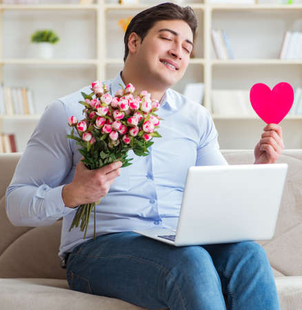 The young man making marriage proposal over internet laptop Banco de Imagens