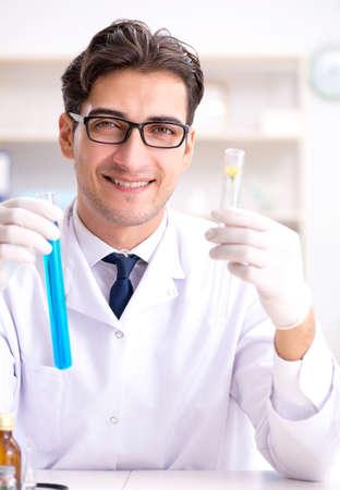 The biotechnology scientist chemist working in lab Stok Fotoğraf