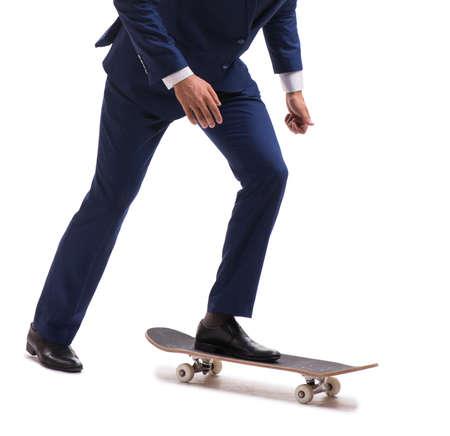 Businessman riding skateboard isolated on white background 版權商用圖片
