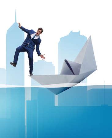 Businessman escaping sunken paper boat ship 免版税图像
