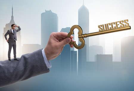 Businessman with key to success business concept Banco de Imagens