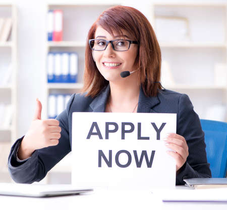 Businesswoman hiring new employees in office Banque d'images