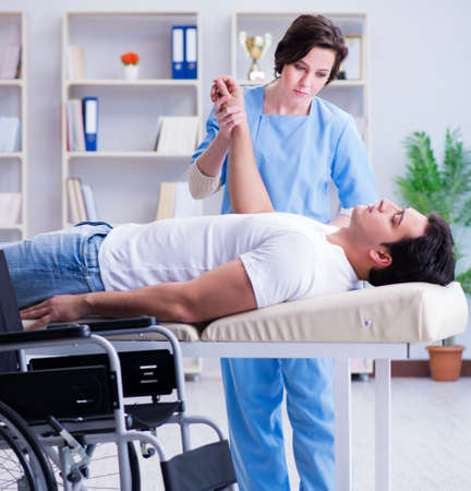 Patient undergoing rehabilitation recovery programme with doctor