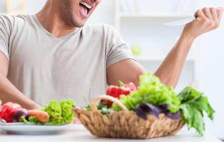 Giovane nel concetto mangiante e stante a dieta sano