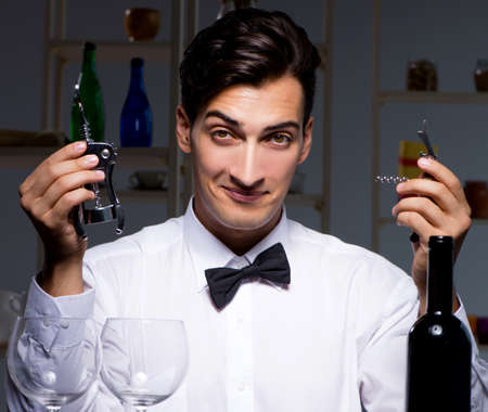 Professional sommelier tasting wine in restaurant