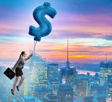 The businesswoman flying on dollar sign inflatable balloon