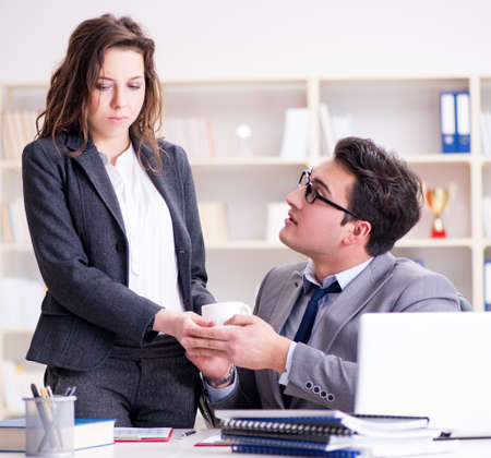 The sexual harassment concept with man and woman in office