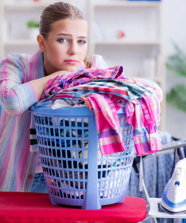 Tired depressed housewife doing laundry Stock fotó