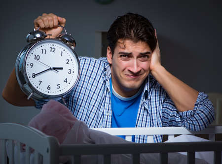 The young father under stress due to baby crying at night