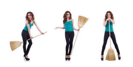 Young woman with broom isolated on white