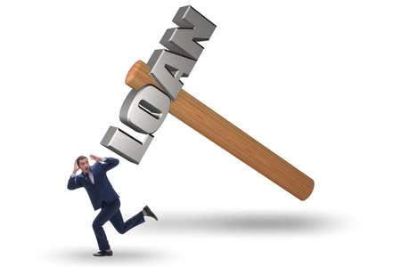 Businessman under the burden of debt and loan