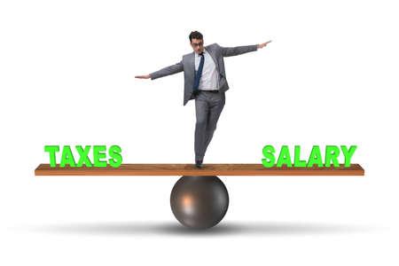 Businessman balancing between taxes and salary Zdjęcie Seryjne