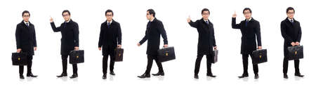 Young man holding suitcase isolated on white