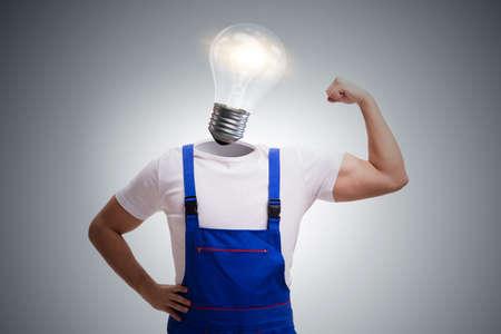 Worker in bright idea concept Stockfoto