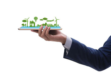 Hand holding tablet with mini ecosystem and clean energy 版權商用圖片