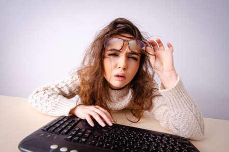 Funny nerd girl working on computer 写真素材