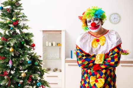 Funny clown in Christmas celebration concept Фото со стока