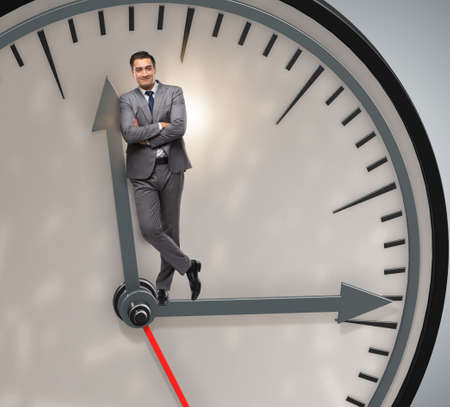 Businessman in time management concept Reklamní fotografie
