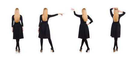 Woman in long black dress isolated on white 写真素材