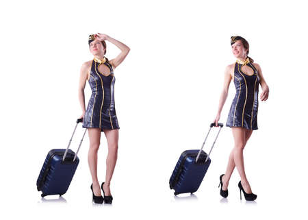 Woman travel attendant with suitcase on white Stockfoto