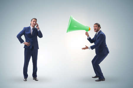 Businessman shouting through large loudspeaker Imagens