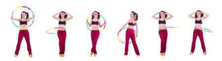 Woman doing exercises with hoop Stockfoto