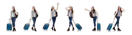 Smiling caucasian girl walking with suitcase isolated on white