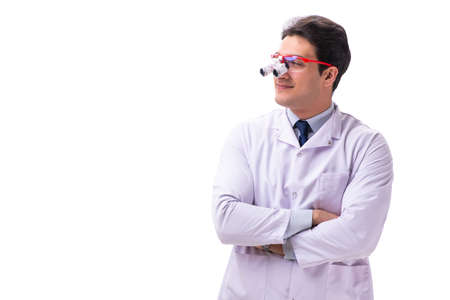 Young male doctor with magnifying glasses isolated on white
