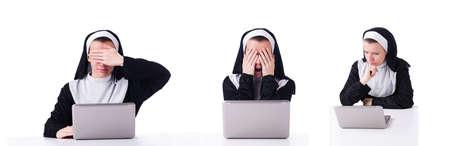 Nun working on laptop - religious concept