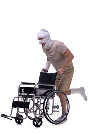 Injured man in wheel-chair isolated on white Imagens