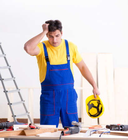 Floor repairman disappointed with his work Stok Fotoğraf