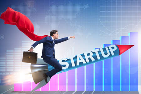 Superhero businessman in start-up concept flying rocket