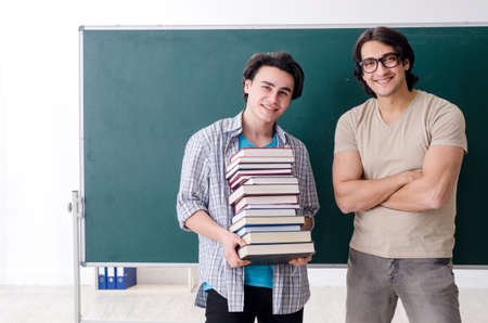Two male students in the classroom 写真素材