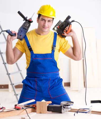 Floor repairman disappointed with his work Stockfoto
