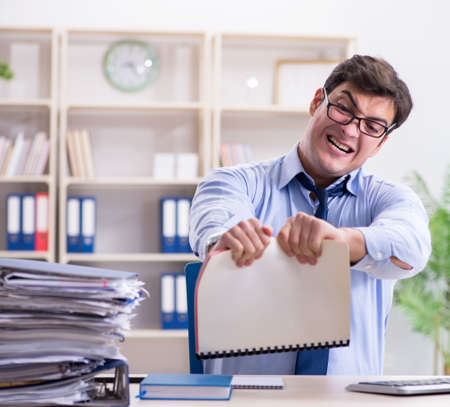 Tired businessman with too much paperwork