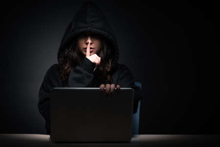 Female hacker hacking security firewall late in office Stok Fotoğraf