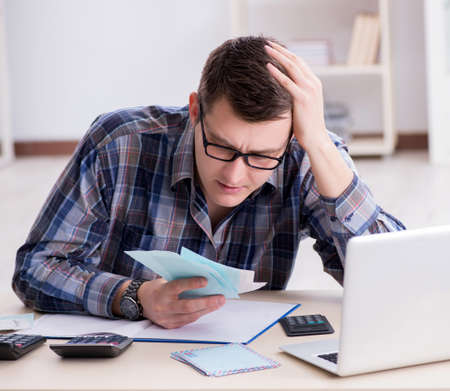Young man frustrated at his house and tax bills