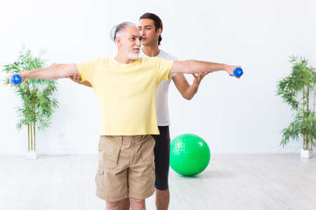 Old man doing exercises indoors