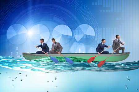 Disagreement concept with businessmen rowing in different direct 写真素材 - 131877982