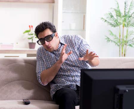 Man watching 3d tv at home