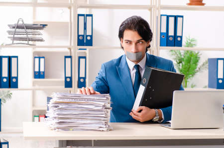 Young male employee with tape on the mouth Stockfoto