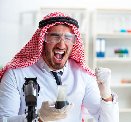 Arab chemist scientist testing quality of oil petrol
