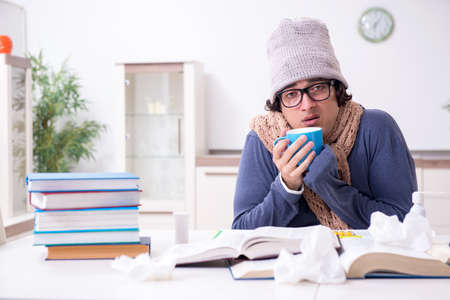 Sick male student suffering at home